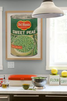 Decorating your walls is a simple way to reinvent your kitchen. For a bold look, display word signs like 'Eat,' 'Diner' or 'Kitchen.' (The brighter the colors, the better!) If you want to go the authentic route, display vintage advertising posters (like this kitchen's 1960s supermarket ad), road signs, vintage license plates or framed vinyl albums—all of which can be found on Amazon or eBay.