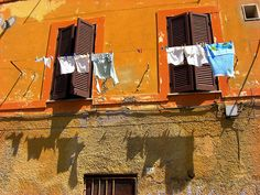... facade with clothes hanging to dry in the sun nettuno lazio italy
