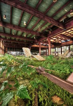 Grossinger's Resort in Liberty, N.Y., once entertained 150,000 guests per year and had its own airstrip and post office, but has been abandoned since 1986. The wooden ceiling beams and light fixtures are amazing.