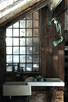 """<3 this rustic """"kitchen"""" space.  cool lamp"""