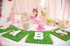 Decorate with flower garlands and fake grass placemats, hang a doily garland to make it more shabby chic