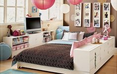 I like how the dresser is used against the bed (or part of it) could be used as a way to separate the girls.