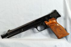 """Model 41 S&W - #A139228 .22LR. An almost mint """"A"""" prefix pistol with 7 3/8"""" target barrel, muzzle compensator, and cocking indicator. All in its original box with accessories and papers. This pistol dates to the mid-1970s. $1,450.00"""