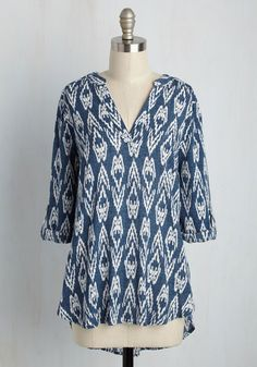 After whipping up breakfast treats in this blue top, you invite your pals over for a surprise pastry tasting! They devour your wares with delight, and between bites ask about the ivory print and texturing of your tab-sleeved blouse - a piece they love hearing about about again and again.