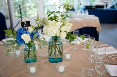 Blue hydrangea and white rose simple centerpieces in blue glass vases by Heavenly Hydrangeas/Photography by Mandi