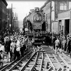 Baldwin Locomotive Down Vine Street -The 60,000th locomotive built by Baldwin, #60000 (an experimental 4-10-2 steam locomotive built in 1926) draws a large crowd of curious onlookers as it is moved - at 4-feet per minute! - down Philadelphia's Vine Street to the Franklin Institute in 1933