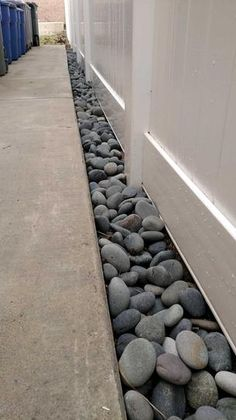 This excellent Vigoro Mexican Beach Pebbles is ideal for many landscaping applications, including around trees, shrubs, decks, driveways and more. Side Yard Landscaping, Landscaping Supplies, Landscaping With Rocks, Backyard Patio, Landscaping Ideas, Decorative Rock Landscaping, Backyard Beach, Florida Landscaping, Backyard Ideas