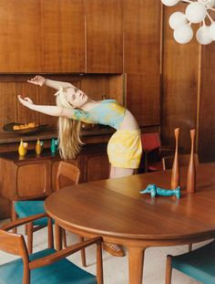 {Elle Fanning & a lot of teak} + love that blue doxie figurine; photo for Self Service