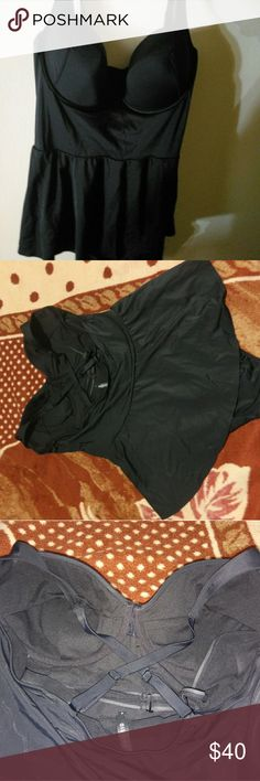 Torrid swimsuit NWOT criss-cross back option Get ready for Summer!!! Plus size Torrid swimsuit, New without tags. Hygiene liner in place, black with straps you can cross or uncross in the back!! Torrid size 4 (which is size 26). Underwire with a little bit of padding for support torrid Swim One Pieces