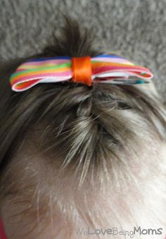 Braid Okay, so those of you who have tried to braid a toddlers hair know it is pretty hard to get that baby thin hair to stay right? Good news...you can still do the braid.  I braided about half way and then secured the braid with a clear elastic and then finished braiding from there. You can't even see the elastic because it gets tucked in the the braid.  This trick will help the braid stay in all day too!