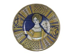 Plate  Italian, Deruta, 1520 - 1540   Earthenware, tin glaze   National Museum Of Scotland, A.1877.20.117   Maiolica dish painted in dark blue and yellow lustre and decorated with the portrait of a lady.