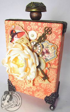 An amazing altered box from @Jim Hankins, the Gentleman Crafter, using A Ladies' Diary! It opens by pulling up the ornate metal door knob! #graphic45
