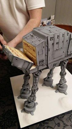 The only more appropriate way to cut this cake would have been to wrap cheese wire around its legs. All hail Star Wars!