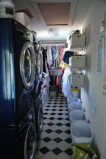 I love this family closet, especially the diaper changing station and the hair stuff!