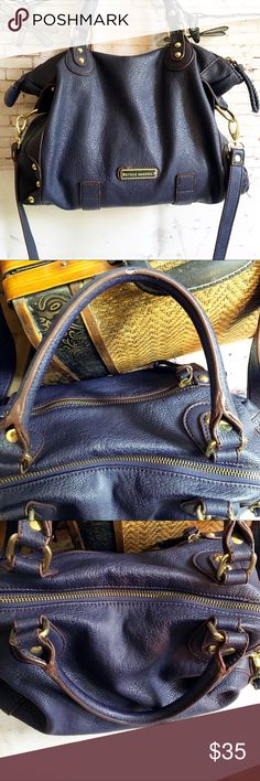 """STEVE MADDEN Satchel, Navy w/Brown Trim Measures 14 x 10 x 4.5.  Very soft, but don't know if leather or not.  Gold hardware.  Zipper pocket.  Attached strap length is 23"""".  Handles are approx 6"""".  Inside clean.  One of the handles has a worn spot. ( probably from holding). See pic. Steve Madden Bags Satchels"""