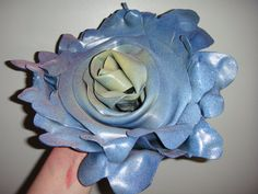 Recycled, upcycled, sculpted vinyl roses, one of a kind works of art. (This is what I was talking about.)