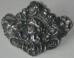 http://redrobinantiques.com/images/Unger_Lady_and_Poppy_Sterling_Brooch.jpg