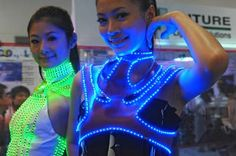 Fabric displays are revolutionizing the marketing and fashion industries by incorporating LED lights into the fabric. Learn more about fabric displays. Smart Textiles, E Textiles, Light Up Clothes, Fabric Display, Burning Man Outfits, Festival Costumes, Led Dress, High Tech Gadgets, Halloween Disfraces