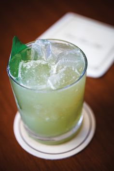 Drink Local, Los Angeles:  The Tower Smash from Delta Sky Magazine.   5–6 basil leaves, lightly muddled  Juice of one lemon + half a lemon for the glass  1/2 oz. simple syrup  1/2 oz. ginger syrup  2 oz. Reposado tequila  Shake and strain all ingredients over lemon half in a bucket glass. Add ice and a basil leaf garnish.