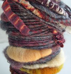"MyMixMix on Etsy. ""Vagabond"" poquito skein mixed fiber hand-spun art yarn. I love that bulgy peach-colored bit & the orangy mustard bit further down."