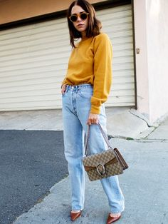 Loose fit is trending. Make sure to tuck in your top to add some shape to your look.
