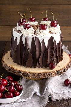 This Black Forest Cake combines rich chocolate cake layers with fresh cherries, cherry liqueur, and a simple whipped cream frosting.   livforcake.com