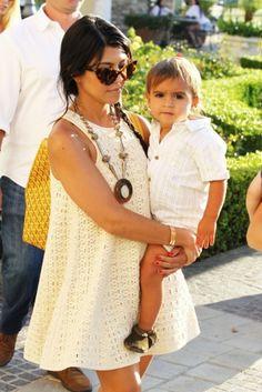 kourtney kardashian & mason. ivory crochet dress, statement necklace, yellow bag.