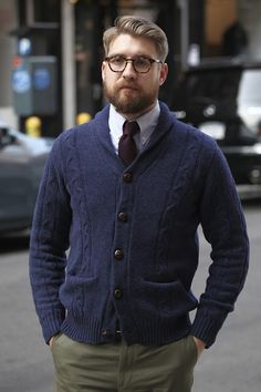 Shop this look for $130:  http://lookastic.com/men/looks/olive-chinos-and-navy-shawl-cardigan-and-blue-longsleeve-shirt-and-burgundy-tie/505  — Olive Chinos  — Navy Shawl Cardigan  — Blue Longsleeve Shirt  — Burgundy Tie