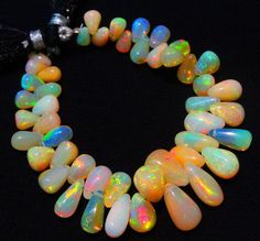 Flashing Fire Play Ethiopian Opal 7*3 to 10*7MM Teardrop Briolettes 50Ct. 5.5""