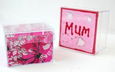 "Our clear shapes (boxes and hanging decorations) look funky with Decopatch paper. The ""Mum"" box was painted on the inside first and then once dry, the plain pink Decopatch paper was added over the top. The patterned box was Decopatched from the inside. Why not fill with a treat or a gift for Mother's Day?"