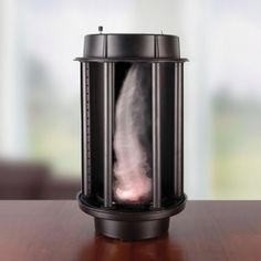 The Desktop Tornado. This is the device that creates a swirling vortex of air on a desktop. A built-in atomizer turns water into a cloud of mist while a fan in the base creates the updraft. Six circulation manifolds generate convergence and rotation, creating a rapidly spinning vertical column of air-the hallmark of any tornado.