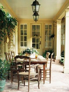 I'm not sure if I love this patio or this furniture more! Gorgeous! The lanterns are the perfect accent.