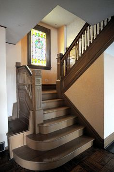 original staircase | The solid oak staircase and stained glass window in the entry date ...
