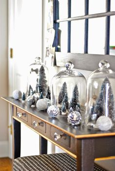 Cute Christmas display with glass cloches and bottle brush trees