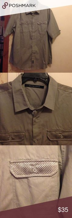 NWT Sean John Button Up NWT gray Sean John button up short sleeve shirt. 2 chest pockets with button closures, cuffed sleeves, netting detail. Size XXL. No trades. Make offers! Sean John Shirts