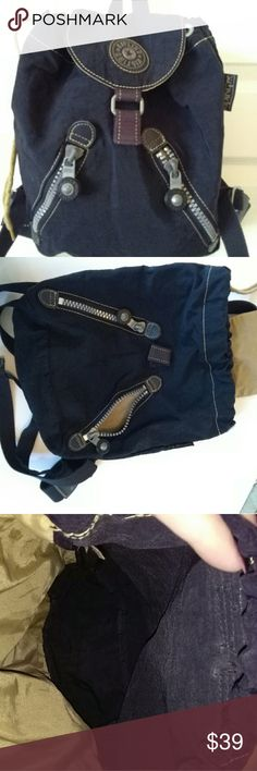 """Kipling Navy Backpack Cute Kipling backpack in good pre-loved condition. Normal wear. No rips, stains clean inside and out. No monkey.  13.5""""W x 11.5""""H. 5"""" deep Adjustable strap's. I attached a small monkey keychain👍 Kipling Bags Backpacks"""