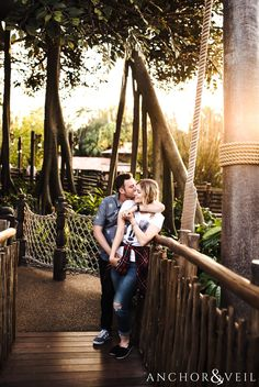 in front of Robinson Crusoe tree house during their Disney world engagement session at Disney's Magic Kingdom