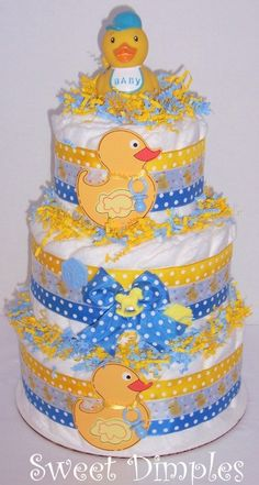 If you've never given a diaper cake as a gift it is a great idea.  Not only does it bring attention to all your guests, but mommy gets to keep all the diapers for baby after the party.