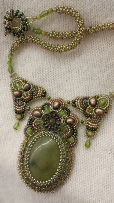 Green floral bead embroidered necklace by Stephanie Bancroft