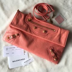 """Balenciaga giant envelope crossbody Balenciaga """"Giant 12"""" tumbled lambskin crossbody bag in blush. Gold hardware including stud and buckle details. Detachable crossbody strap with 21"""" drop. Exterior zip pocket with zip pull. Flap-top with magnetic snap closure. Inside, black cotton twill lining. Divided open compartments. One zip pocket; leashed hand mirror. 7.5""""H x 12.3""""W x 1.8""""D. Brand new but generic dustbag, original dustbag was not provided.  NO TRADES. Will be sent to poshmark first…"""