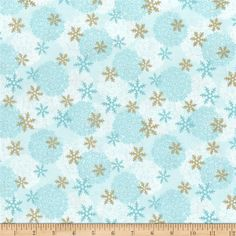 Paris Christmas Metallic Snowflakes Blue from @fabricdotcom  Designed by A. E Nathan, this cotton print is perfect for apparel, quilting and home decor accents. Colors include white shades of blue and gold metallic accents.