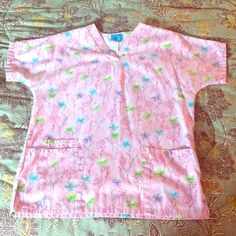 Pink floral scrub top Pink flower scrub top size small. No stains! HQ Tops Tees - Short Sleeve