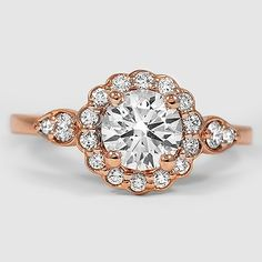 A stunning halo of diamonds creates a romantic floral effect.