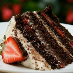 Chocolate Strawberry Truffle Cake - The cake is rich, moist and chocolatey, with a strawberry chocolate ganache slathered on between layers, sliced strawberries, and a white chocolate cream cheese frosting.