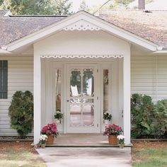 I just love the cottage feel of this!  The trim is adorable as well as the screen door.