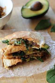 Caramelized Onion, Spinach, and Avocado Quesadillas! we have this new electric quesadilla maker that has become a staple in our home due to our crazy work schedules! This looks like it will be added to our quesadilla recipes! Veggie Recipes, Mexican Food Recipes, Great Recipes, Vegetarian Recipes, Cooking Recipes, Favorite Recipes, Healthy Recipes, Spinach Recipes, Gourmet Sandwiches