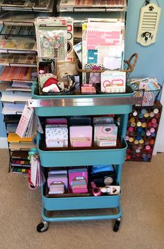 Raskog Cart for Project Life - Scrapbook.com  Top shelf contains stamps, inks, adhesive, tags and stickers. Middle has specialty PL cards and the bottom shelf has core kits and punches. I have a couple hooks on the side to hang my hoop of washi and rings of enamel dots.