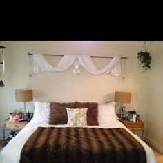Different kind of 'headboard'. Drapes with crystal baubles= lovely Of course the furriest blanket and pillows as accents.