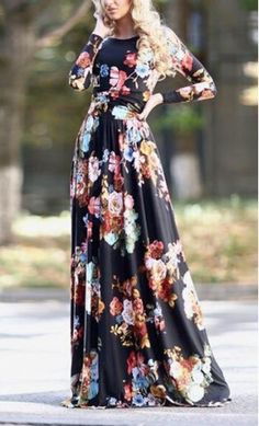 really loving this long sleeve maxi dress with modest neckline and bold floral print