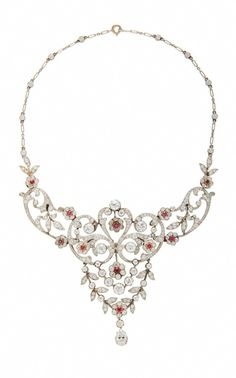 Shop Belle Époque Ruby And Diamond Necklace. From Simon Teakle's curation of fine jewelry, this Belle Époque ruby and diamond necklace is designed with a bib open scroll cluster and garland design with a diamond set back chain mounted in platinum. Ruby And Diamond Necklace, Diamond Pendant Necklace, Diamond Jewelry, Diamond Necklaces, Gold Necklaces, Ruby Necklace, Statement Necklaces, Diamond Rings, Earrings